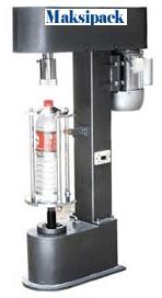 dk-50z-mesin-penutup-botol-plastik-maksipack-pusatmesin